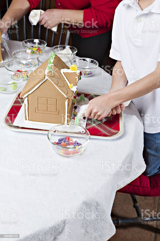 Grandma Helps Making A Gingerbread House royalty-free stock photo