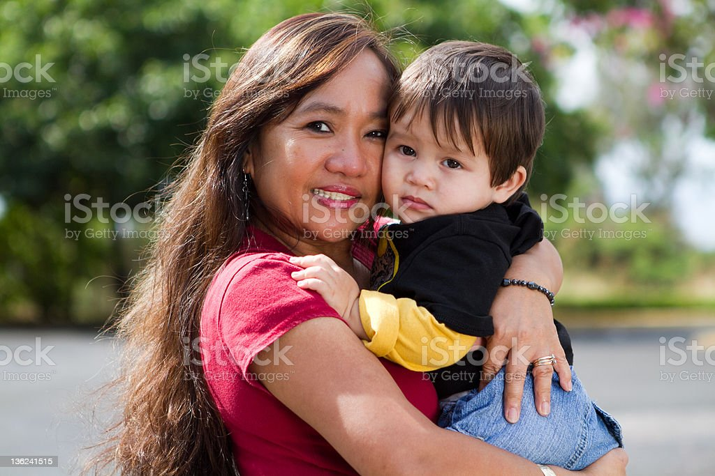 Grandma Hugging Child stock photo