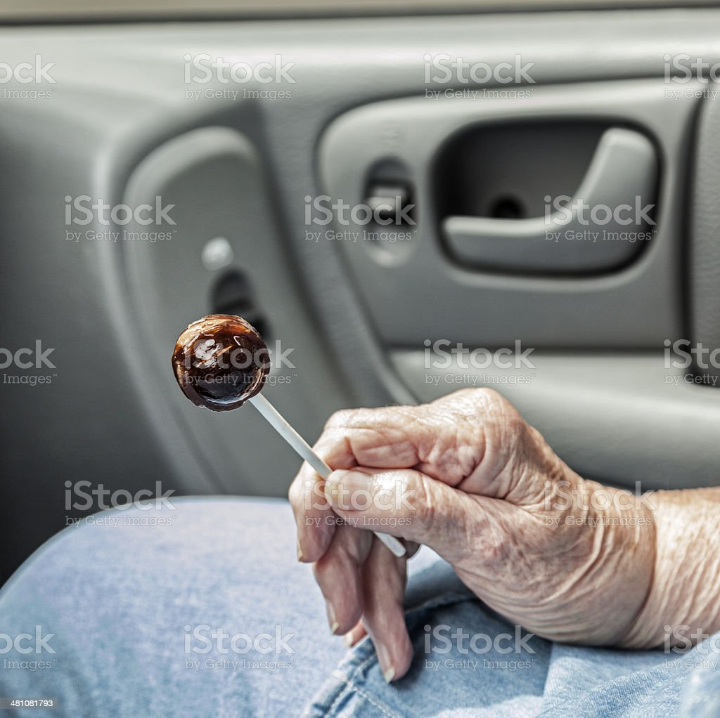 Grandma In Car Holding Lollypop royalty-free stock photo