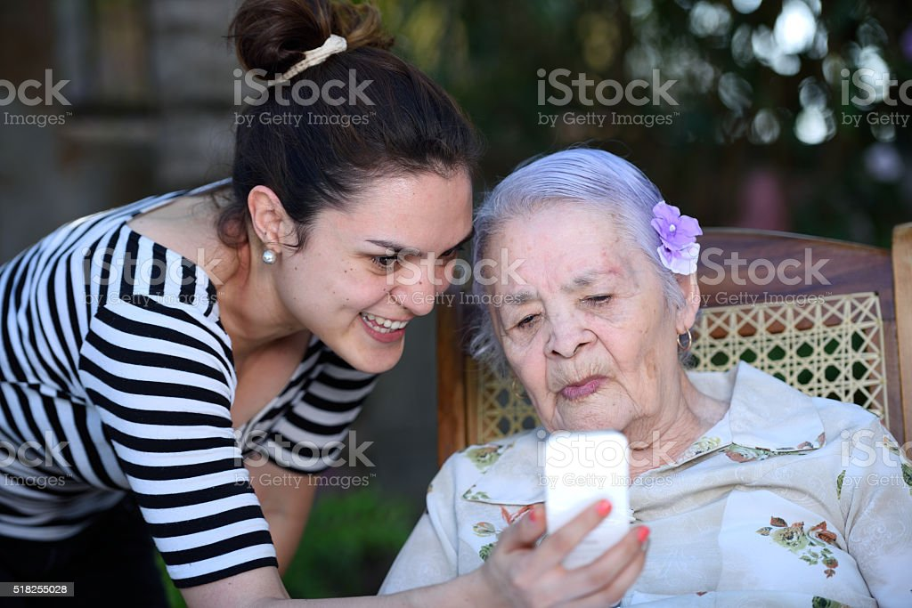 grandma learning use smartphone stock photo