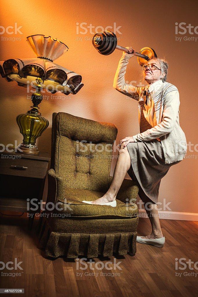 Grandma Lifting Barbell Weights stock photo