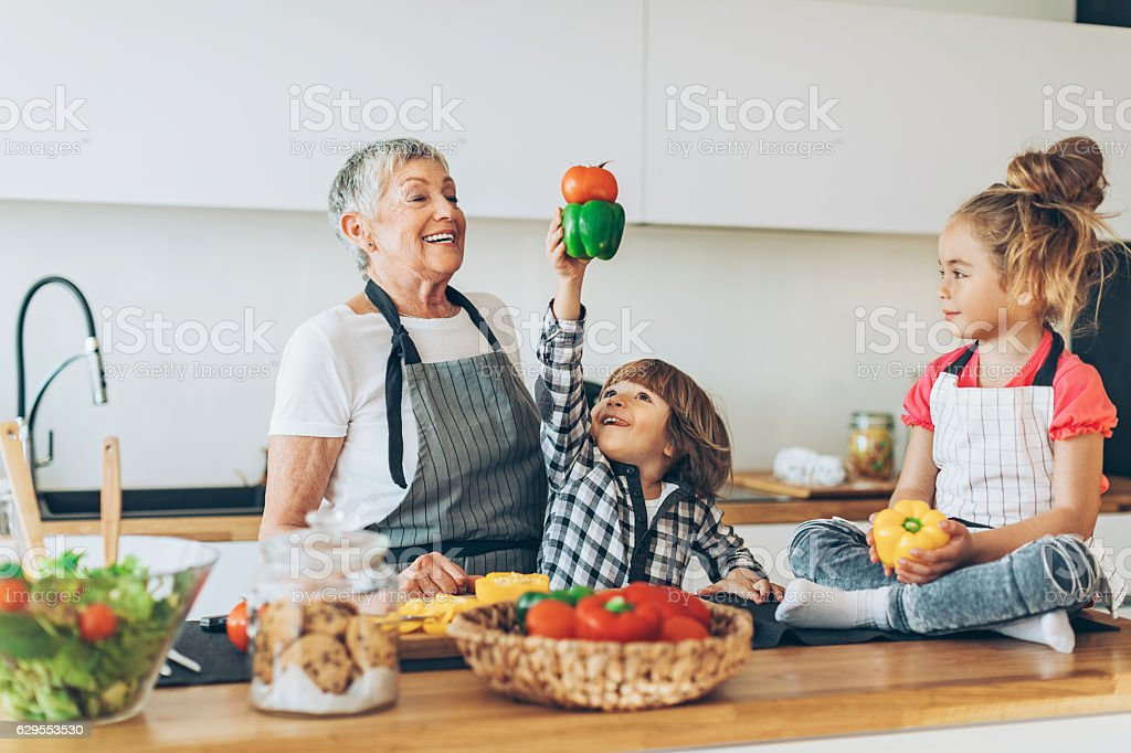 Grandma, look what I can do! stock photo