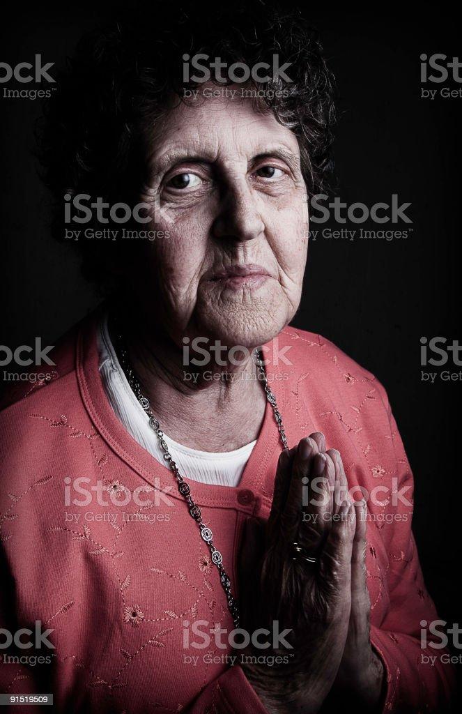 Grandma Praying stock photo
