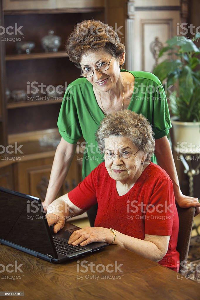 Grandma using laptop stock photo