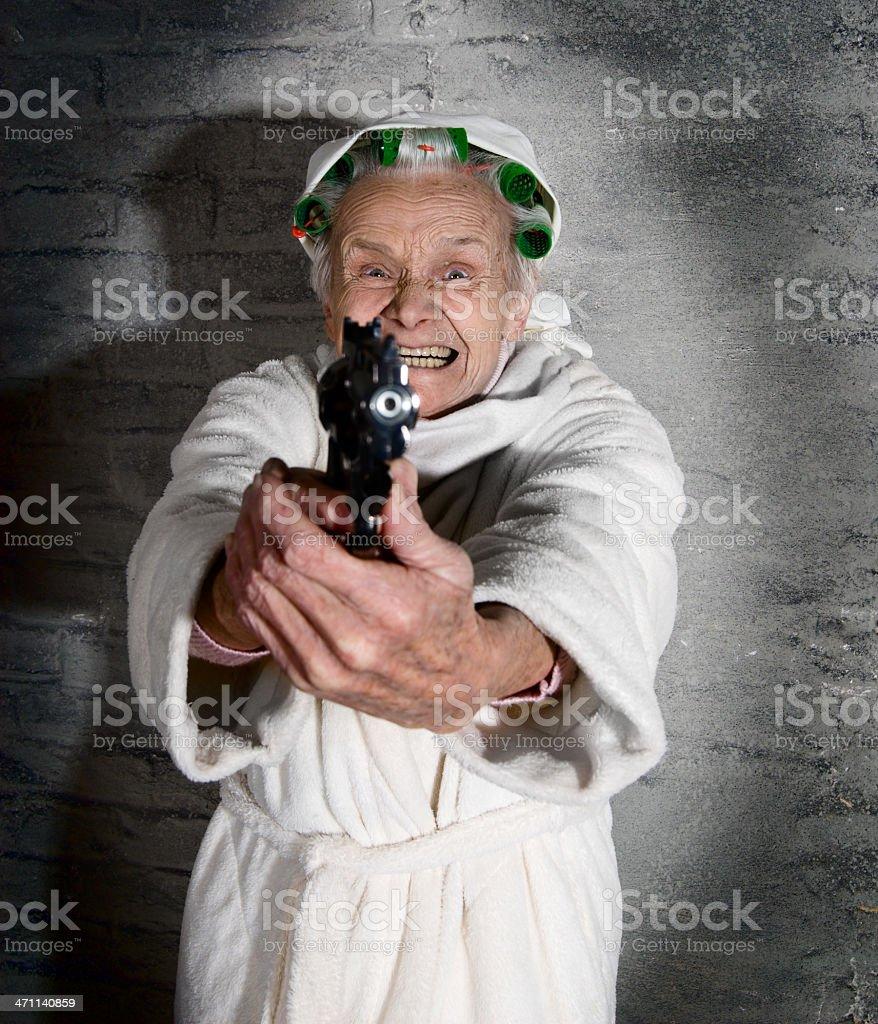 Grandma with gun royalty-free stock photo