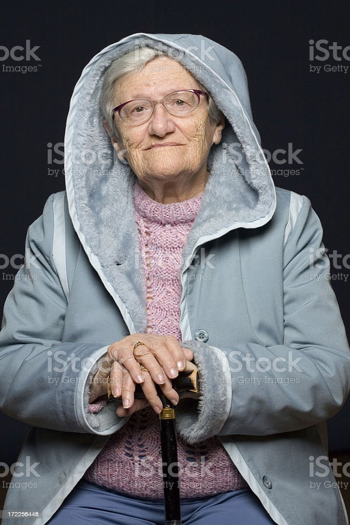 Grandma with Hood and cane royalty-free stock photo