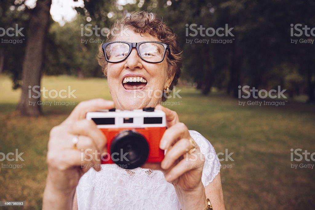 Grandma with retro camera stock photo