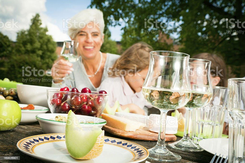 grandmom and their grandchildren are having a picnic royalty-free stock photo