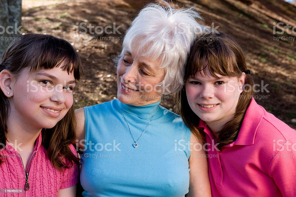 Grandmother Admires Her Grandchildren royalty-free stock photo