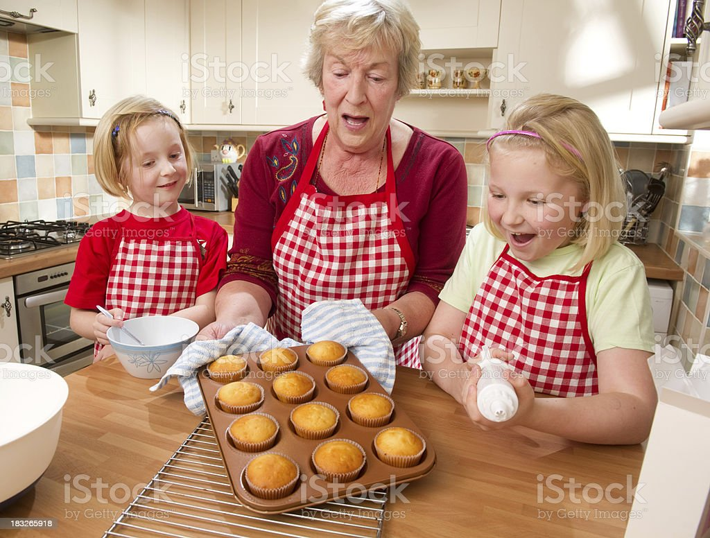 Grandmother and Girls Baking Cupcakes royalty-free stock photo