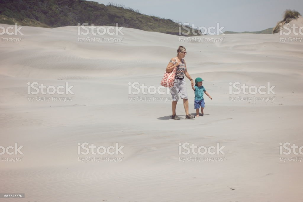 Grandmother and Grandchild in Sand Dunes stock photo