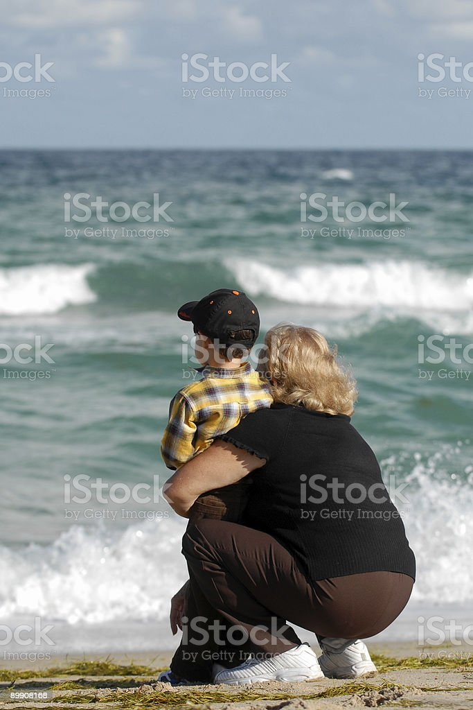 grandmother and grandchild looking at the sea stock photo