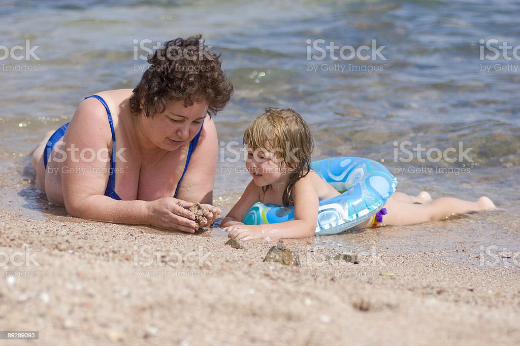 Grandmother and grandchild lying in the water royalty-free stock photo
