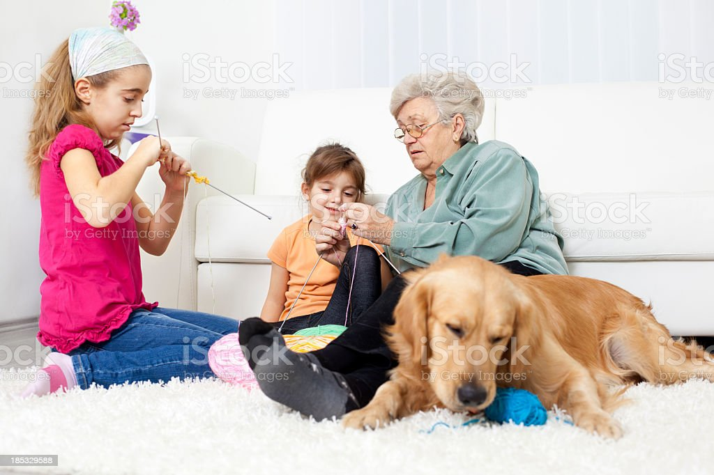 Grandmother and grandchildren knitting at home. royalty-free stock photo