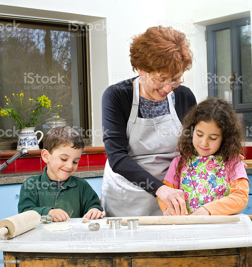 grandmother and grandchilds baking royalty-free stock photo
