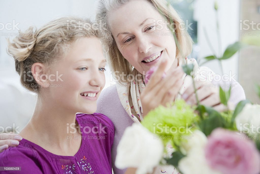 Grandmother and granddaughter arranging flowers royalty-free stock photo