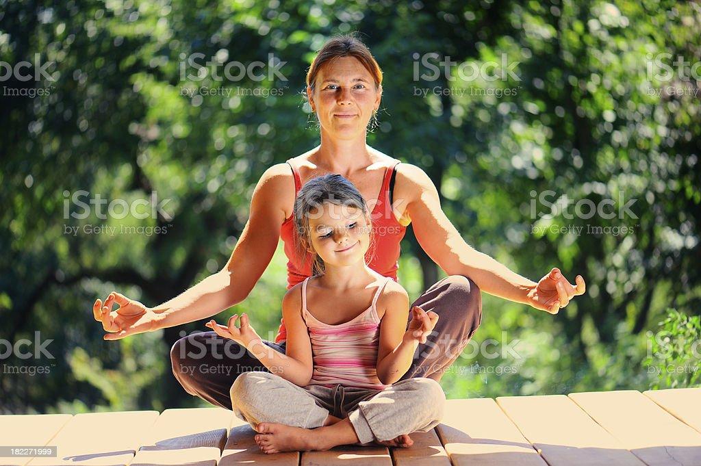 Grandmother and granddaughter at a morning gymnastics royalty-free stock photo