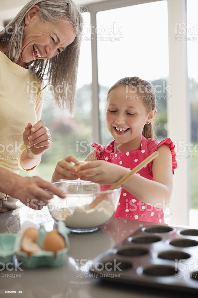 Grandmother and granddaughter baking cupcakes royalty-free stock photo