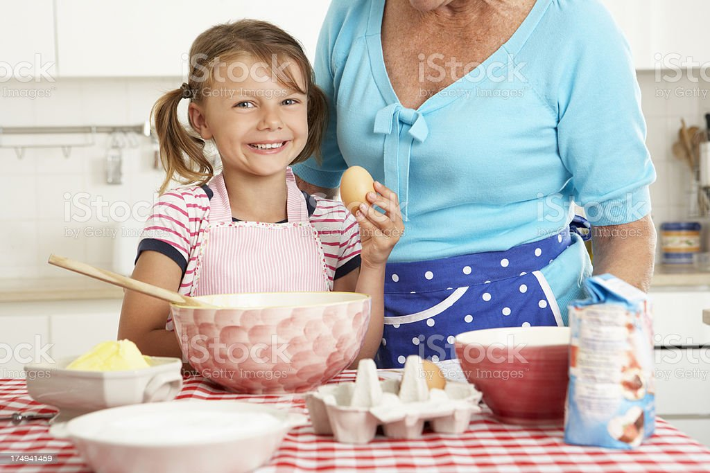 Grandmother And Granddaughter Baking In Kitchen royalty-free stock photo