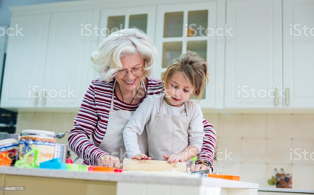 Grandmother and granddaughter baking together stock photo