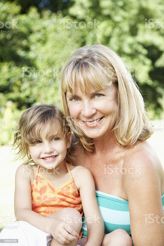 A grandmother and granddaughter being affectionate royalty-free stock photo