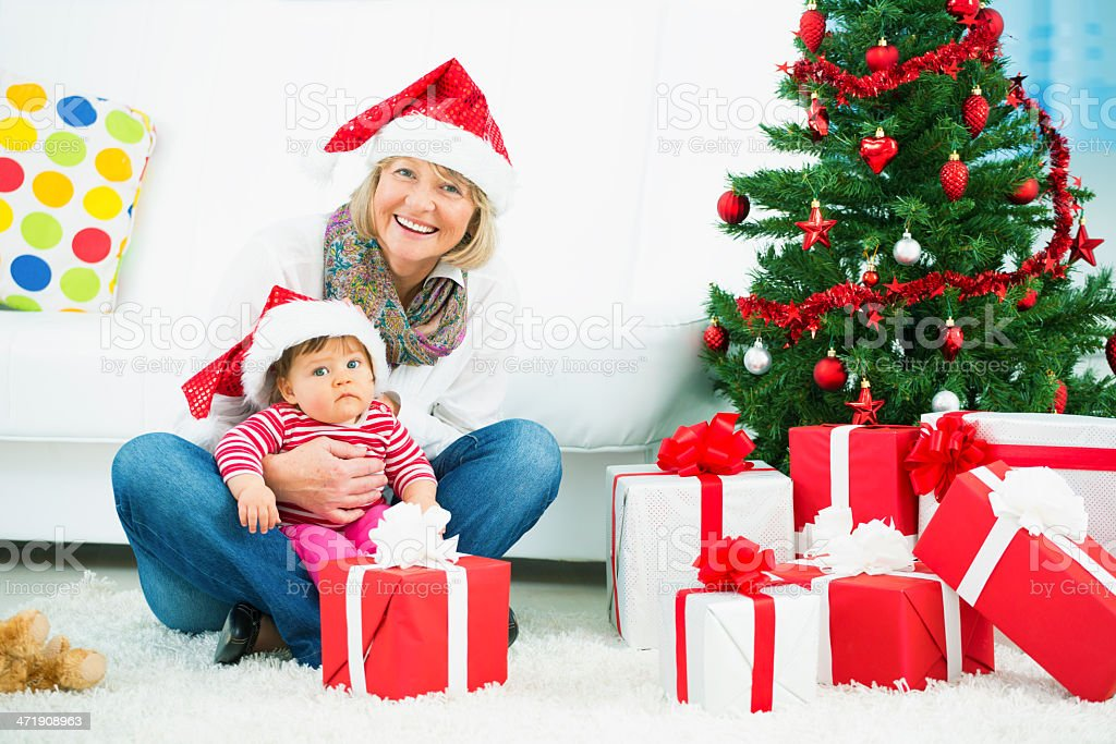 Grandmother and granddaughter celebrating Christmas. royalty-free stock photo