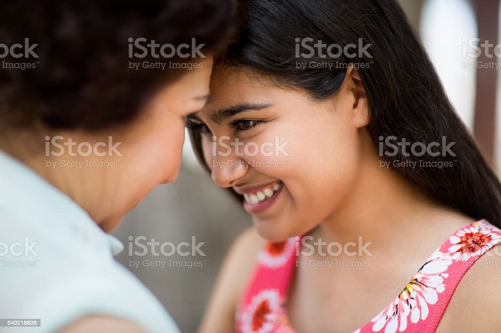 Grandmother and granddaughter close together stock photo