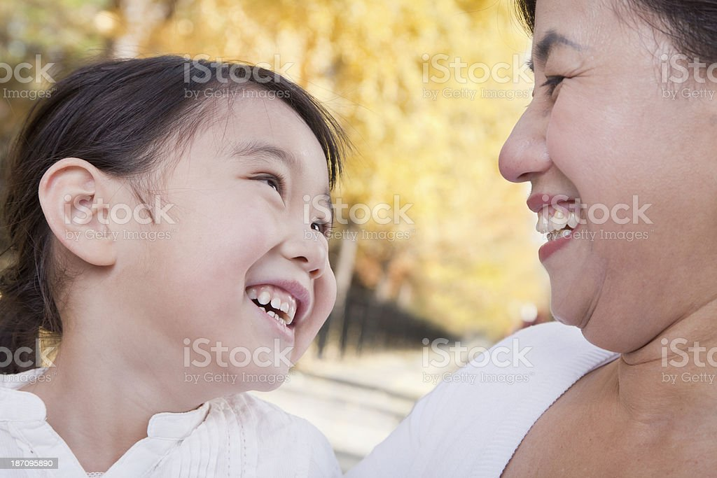 Grandmother and Granddaughter Enjoying the Park in Autumn royalty-free stock photo