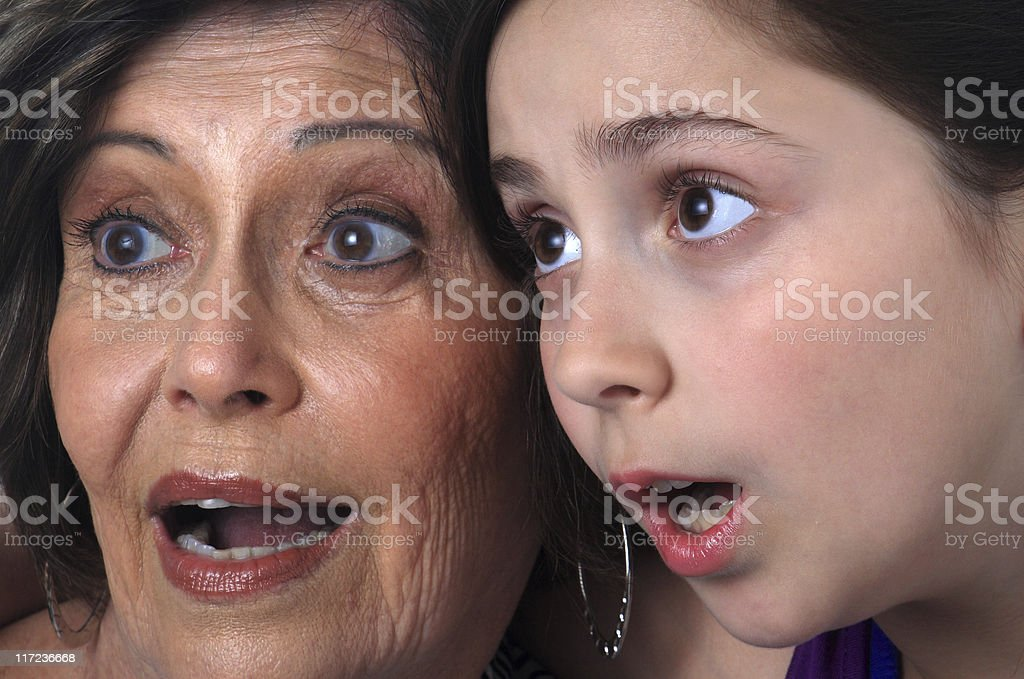 Grandmother and granddaughter frightened royalty-free stock photo