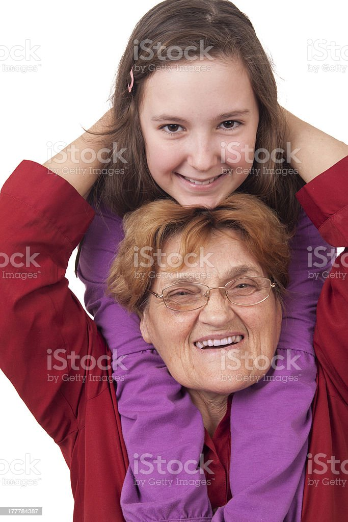 Grandmother and granddaughter hugging royalty-free stock photo