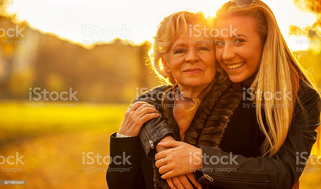 Grandmother and granddaughter in a park. stock photo