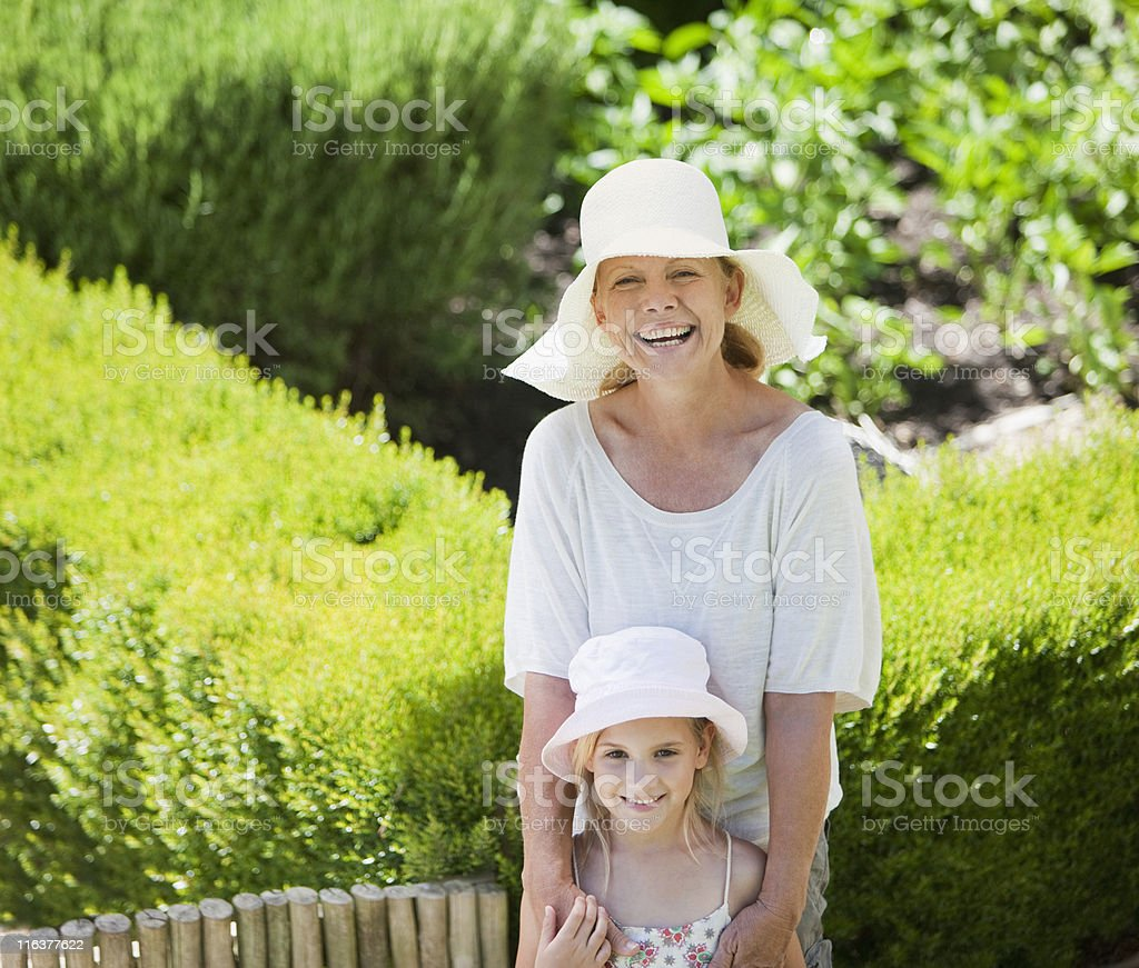 Grandmother and granddaughter in garden royalty-free stock photo