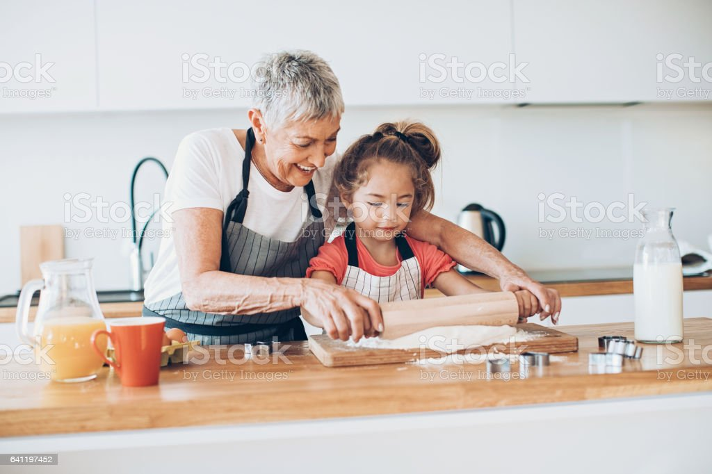 Grandmother and granddaughter in the kitchen stock photo