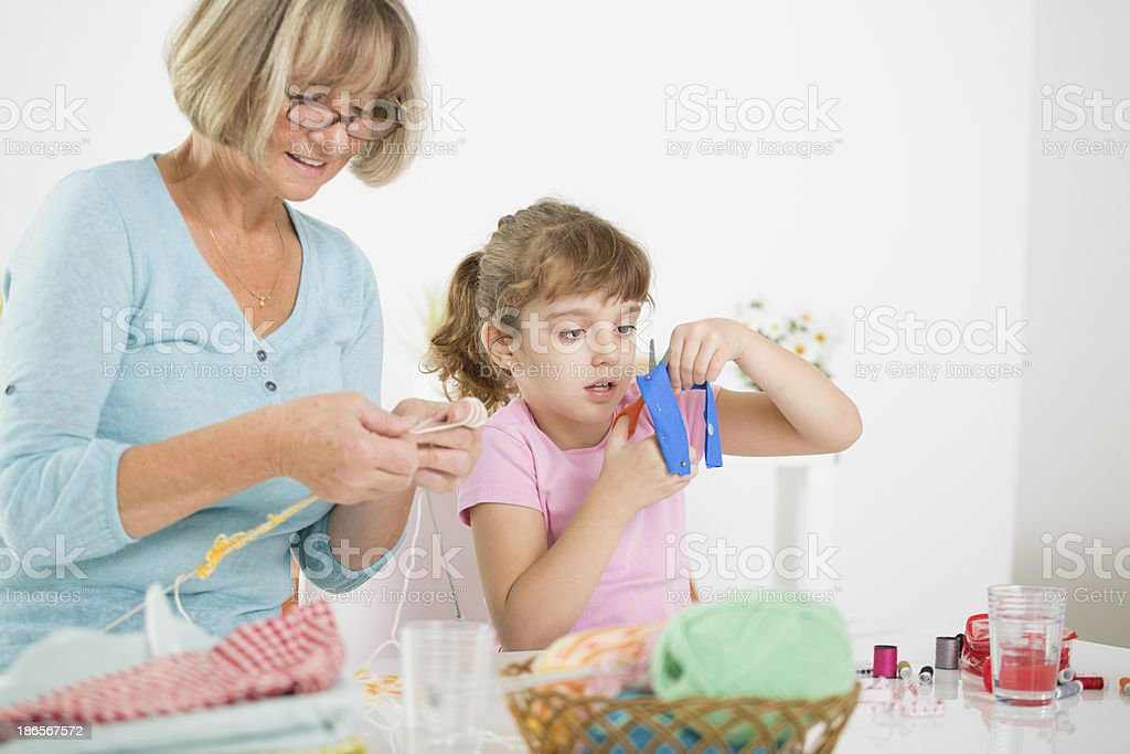 Grandmother and granddaughter knitting. royalty-free stock photo