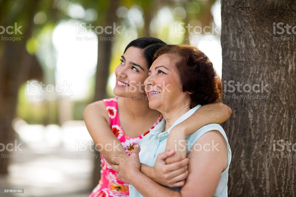 Grandmother and granddaughter looking forward stock photo
