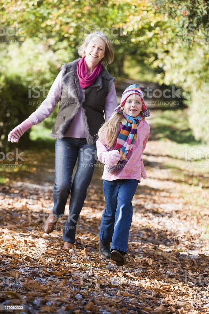 Grandmother and granddaughter playing in woods royalty-free stock photo