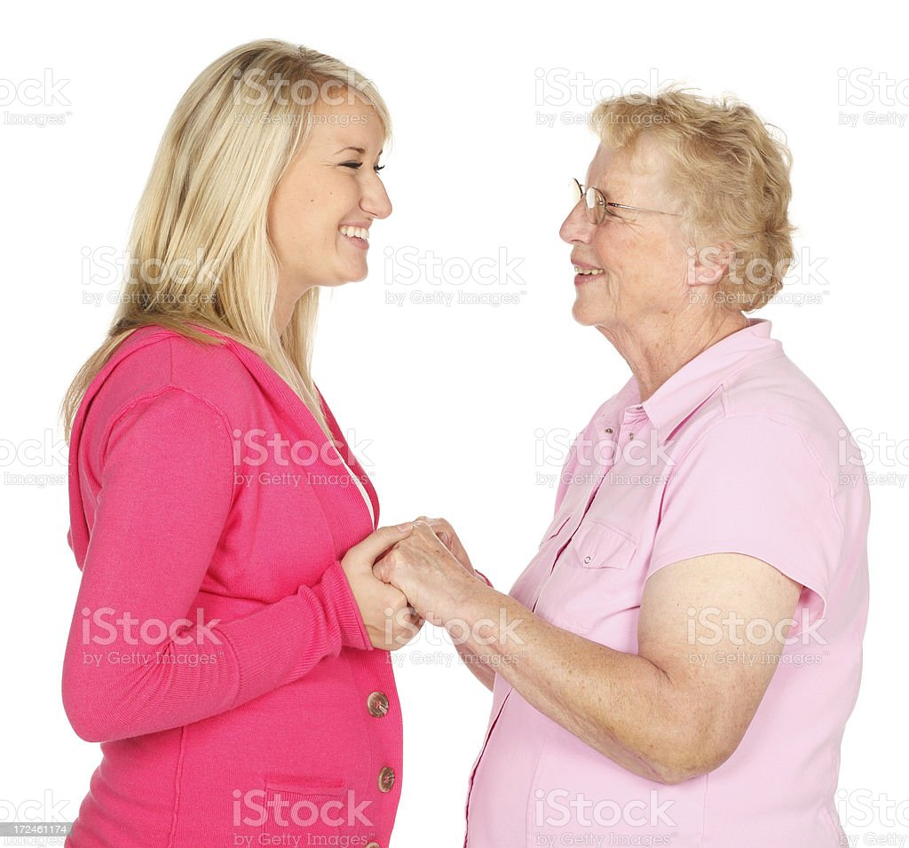 Grandmother and granddaughter portrait on white background. royalty-free stock photo
