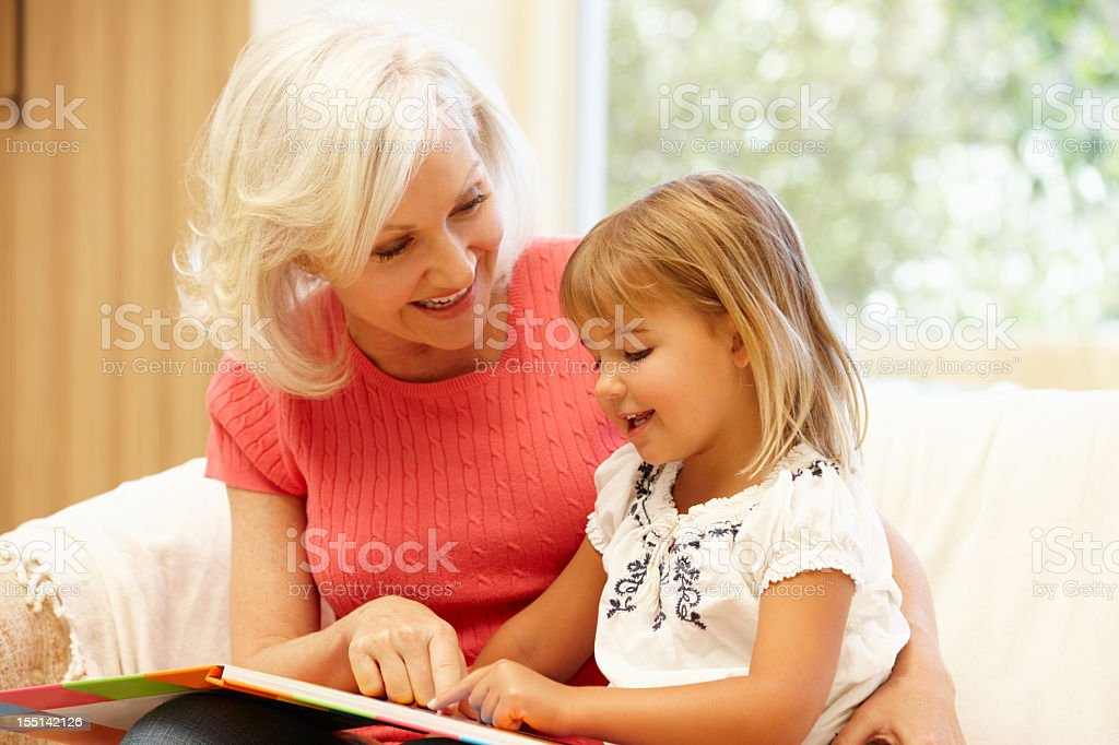 Grandmother and granddaughter reading royalty-free stock photo