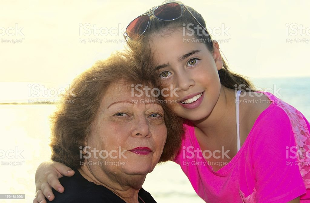 Grandmother and granddaughter sharing a lovely moment near the beach royalty-free stock photo