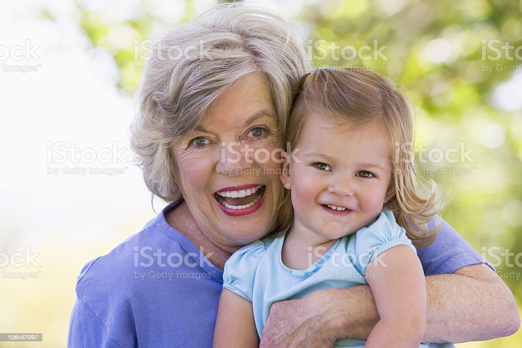 Grandmother and granddaughter smiling royalty-free stock photo