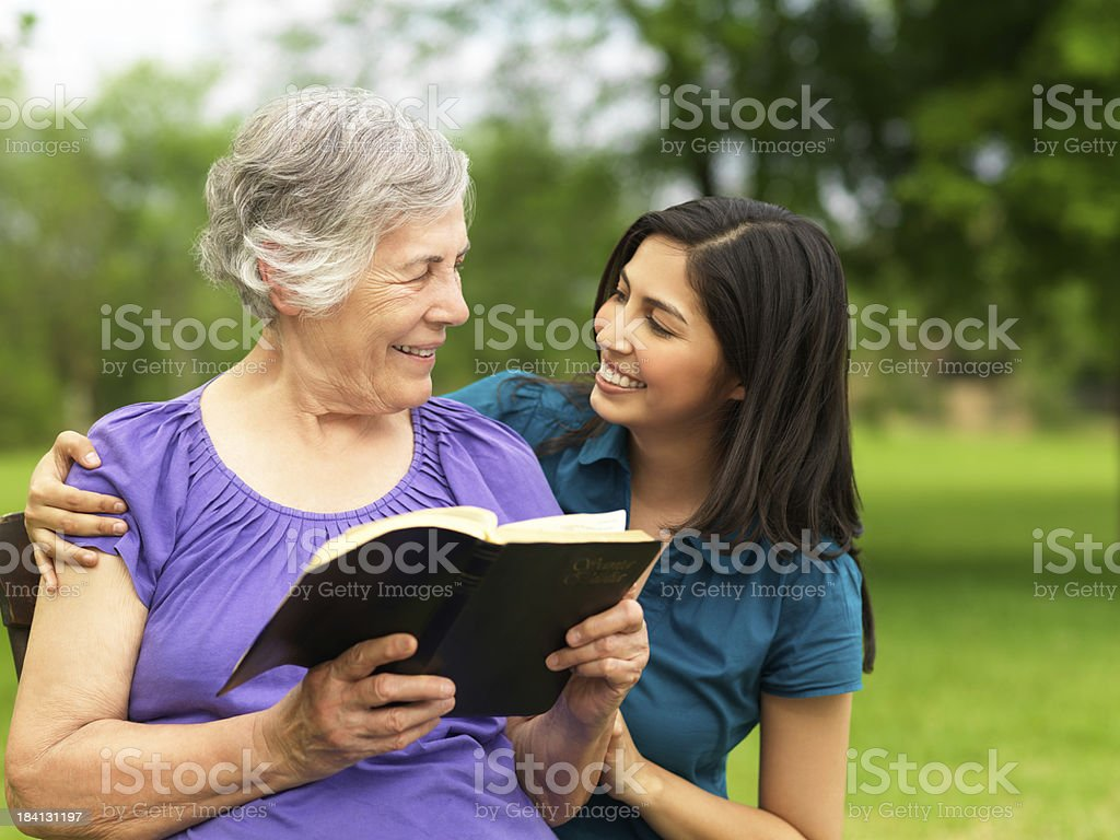Grandmother and granddaughter studying the Bible stock photo