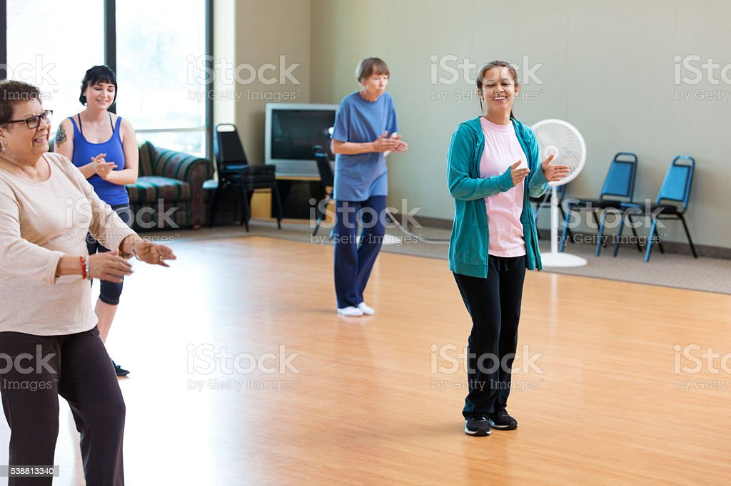 Grandmother and granddaughter take dance lessons stock photo
