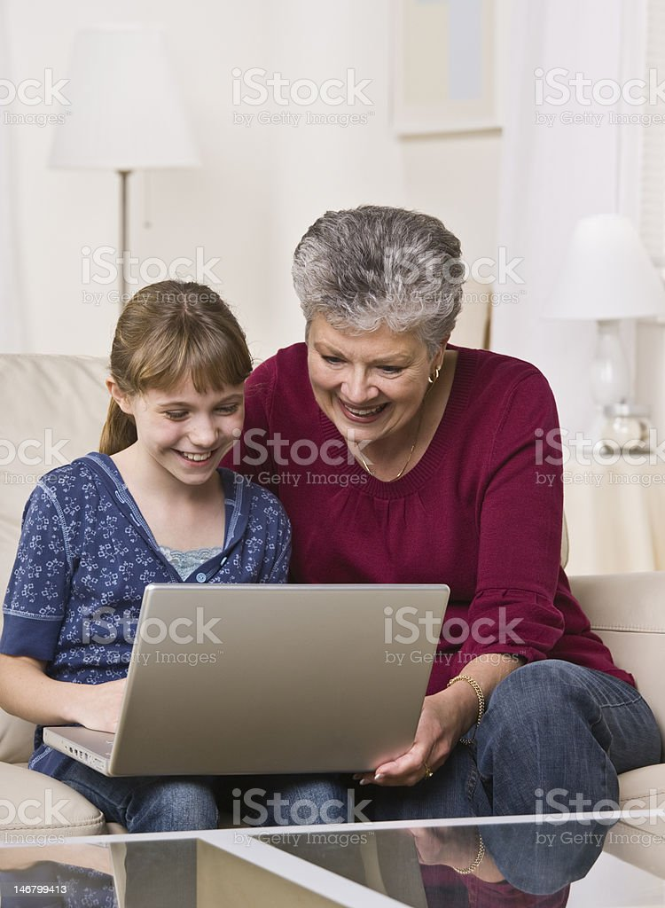 Grandmother and Granddaughter Using Laptop royalty-free stock photo
