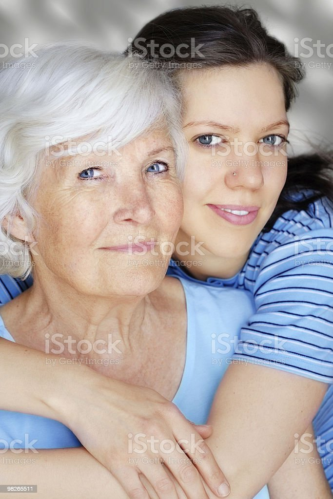 Grandmother and granddaughters hugging and smiling stock photo