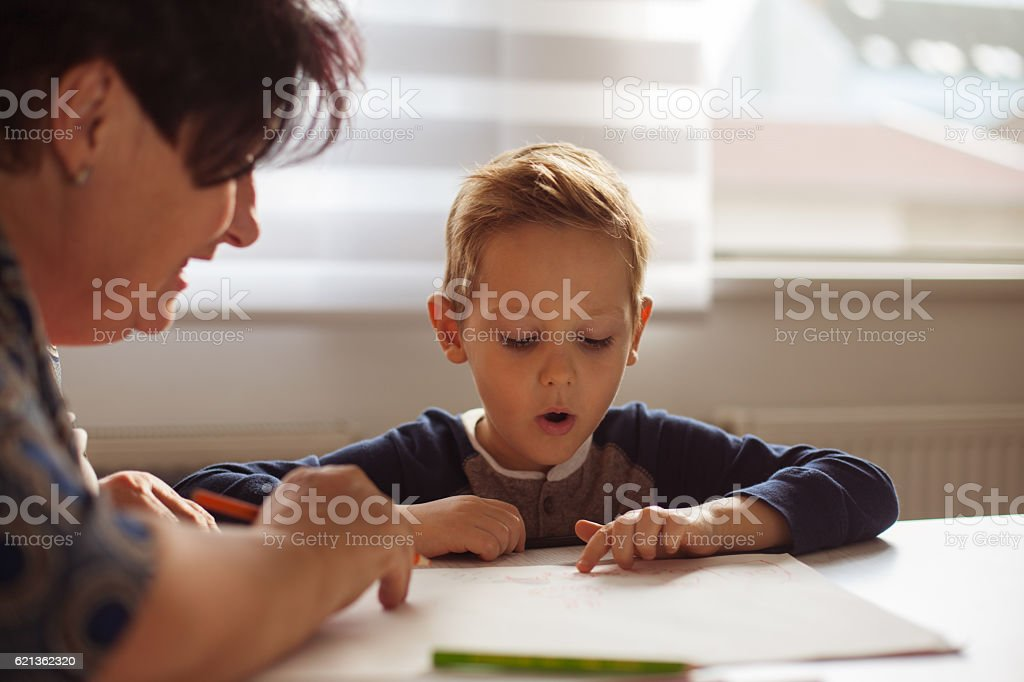 Grandmother and grandson drawing together stock photo