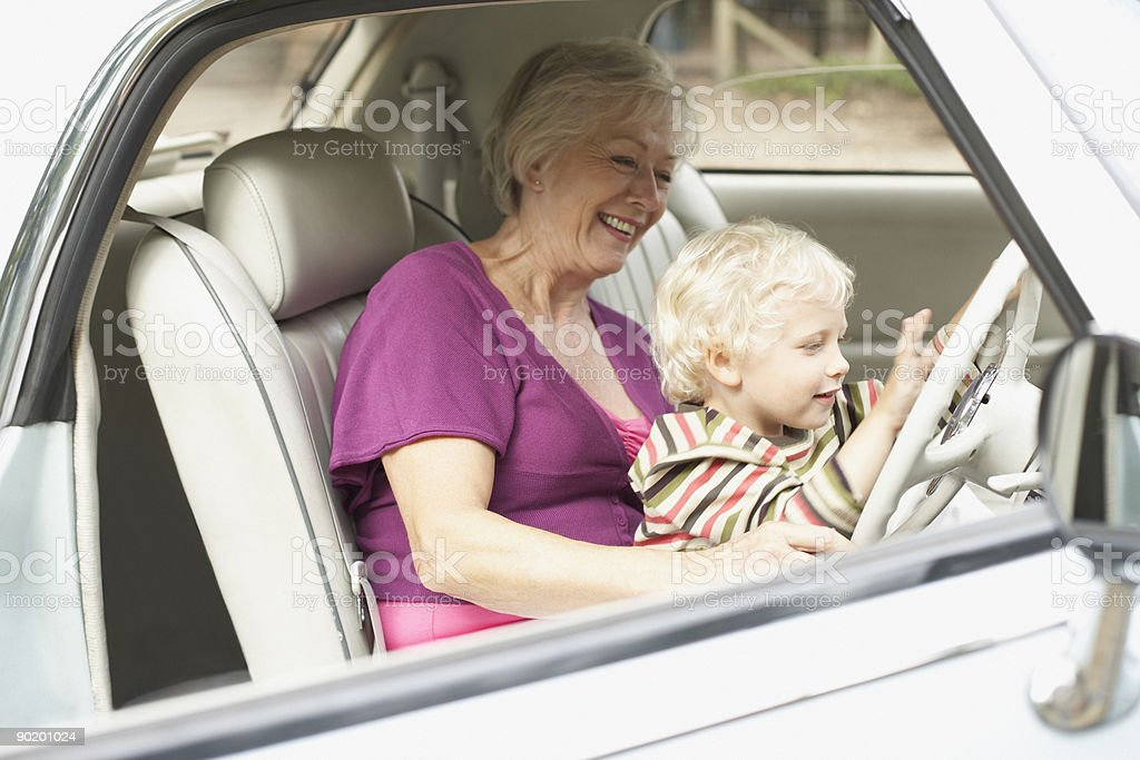 Grandmother and grandson in car royalty-free stock photo