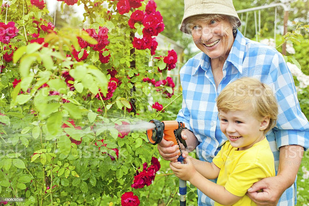 Grandmother and grandson in the garden royalty-free stock photo