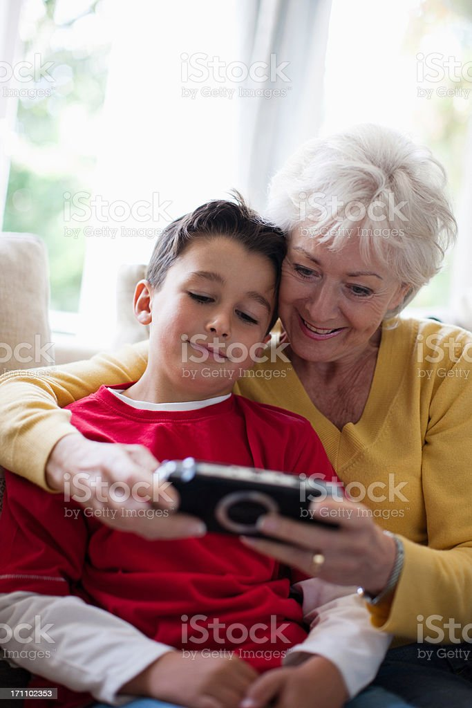 Grandmother and grandson playing video game royalty-free stock photo