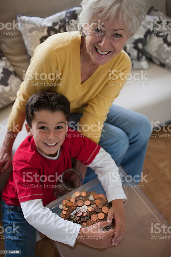 Grandmother and grandson protecting stacks royalty-free stock photo