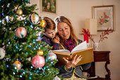 Grandmother and Grandson reading Fairy Tales on Christmas